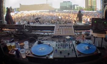 EDM DJ Booth with Big Crowds